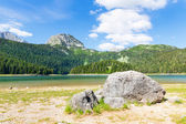 Blue lake and mountains — Stock Photo