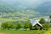 Rural house in mountains — Stock Photo