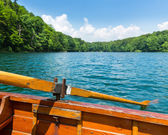 Wooden boat on lake — Stock Photo