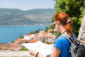 Travelling girl with map — Stock Photo