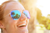 Palm trees reflect in  sunglasses — Stock Photo