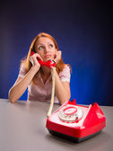 Dreaming girl with red telephone. — Stock Photo