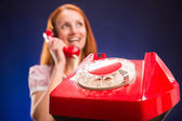 Woman with red telephone — Stock Photo