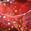 Red cloth with golden stars — Stock Photo #12693040