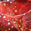 Red cloth with golden stars — Stock Photo