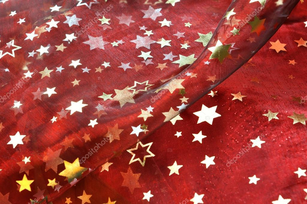 Piece of red cloth with golden stars — Stock Photo #12693074