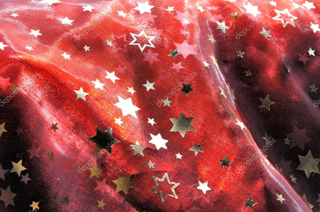 Piece of red cloth with golden stars — Stock Photo #12693154