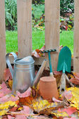 Gardening tools in fall garden — Stock Photo