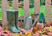 Boots and gardening tools fall — Stock Photo