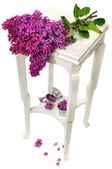 Lilac on small table — Stock Photo