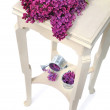 Stock Photo: Lilas on little table