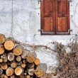 Woodpile and cottage — Stock Photo