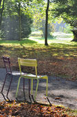 Chairs in a park in autumn — Stock Photo