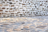 Wall and paving stone — Stock Photo