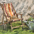 Lounge chair in a country side garden — Stock Photo #44444247