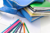 School supplies and book bag — Stock Photo