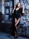 Girl and brick wall — Stock Photo