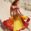 East dancer in sand — Stock Photo