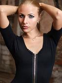 Girl in black combidress — Stock Photo
