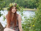 Girl in herbal crown — Stock Photo