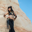 Tribal dancer at the rock — Stock Photo