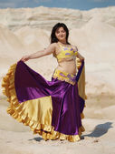 Dancer in violaceous dress — Stock Photo