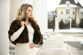 Girl in fur coat in profile — Stock Photo