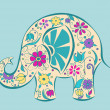 Blue elephant painted by flowers. — Stock Vector #32584663