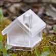 Crystal house over moss — Stock Photo