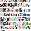 Stock Photo: Colorful newspaper alphabet isolated on white