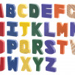 Colorful wooden alphabet isolated on white — Stock Photo #26745129