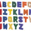 Colorful wooden alphabet isolated on white — Stock Photo