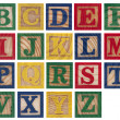 Wooden alphabet blocks isolated on white — Stock Photo