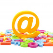 Email symbol and colorful letters on white background — Stock Photo