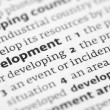 Development definition in a dictionary — Stock Photo
