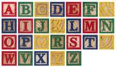 Wooden alphabet blocks isolated on white — Stock Photo
