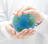 Globe in hands — Stock Photo