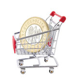 Shopping cart with polish coin on white background — Stock Photo