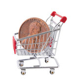 Shopping cart with penny on white background — Stock Photo