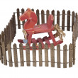 Stock Photo: Rocking Horse Enclosed in Picket Fence