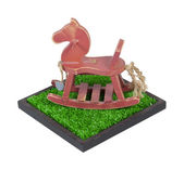 Rocking Horse in a Grass Field — Stock Photo