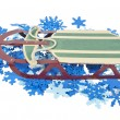 Sled on a Bed of Colorful Snowflakes — Stock Photo #5900290