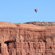 Hot Air Balloon Above Sandstone Mesa - Stock Photo