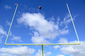 American Football and Goal Posts — Stok fotoğraf