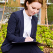 Business woman with clipboard — Stock Photo #51342999