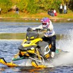 Snowmobile watercross — Stock Photo