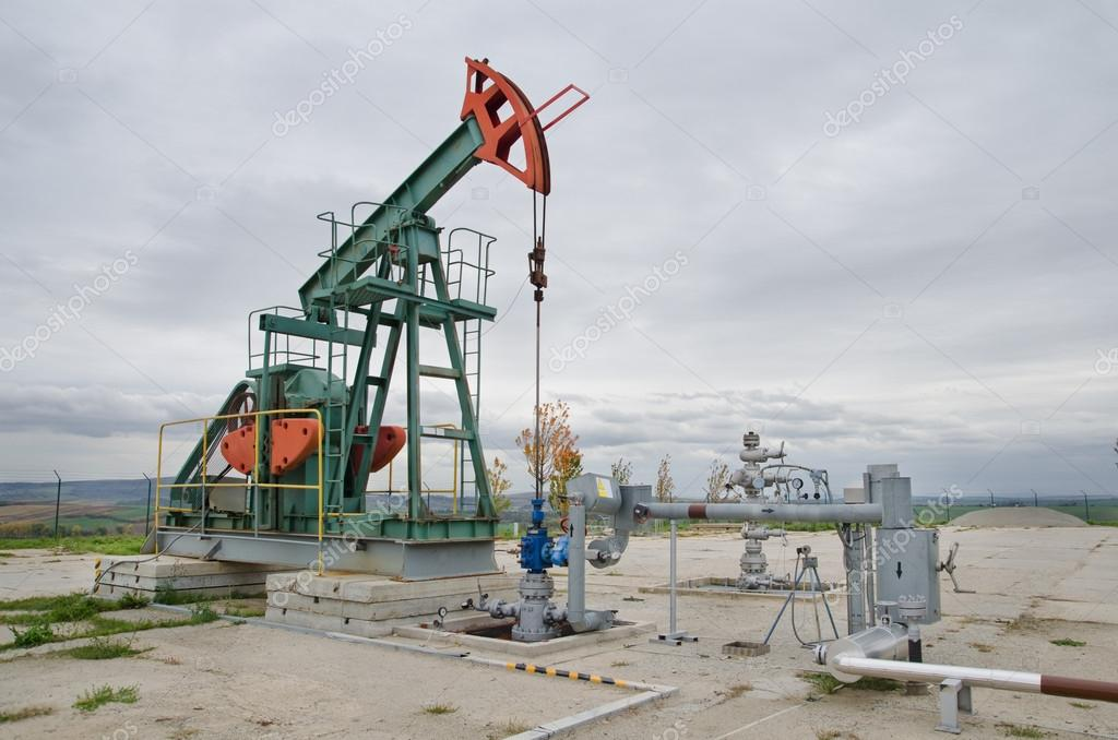 Small pump jack mining crude oil  Stock Photo #14143675