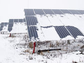 Solar panels covered with snow — Stock Photo