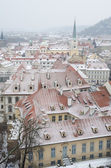 Snowy roofs of Prague — Stock Photo