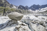 Alpine landscape with cracked glacier and mountains — Stok fotoğraf